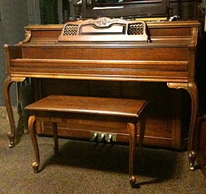 Lowrey piano, $1,200.00